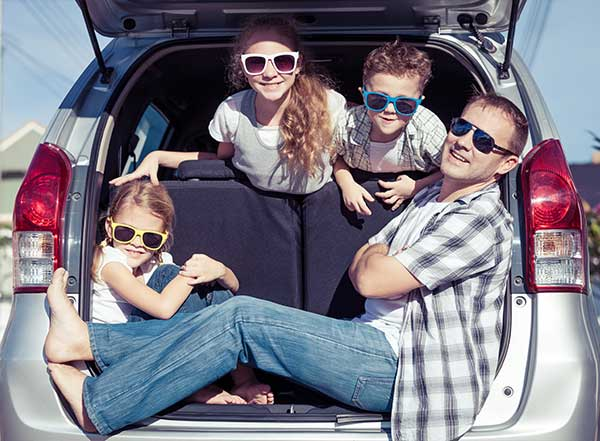 family in a van travel